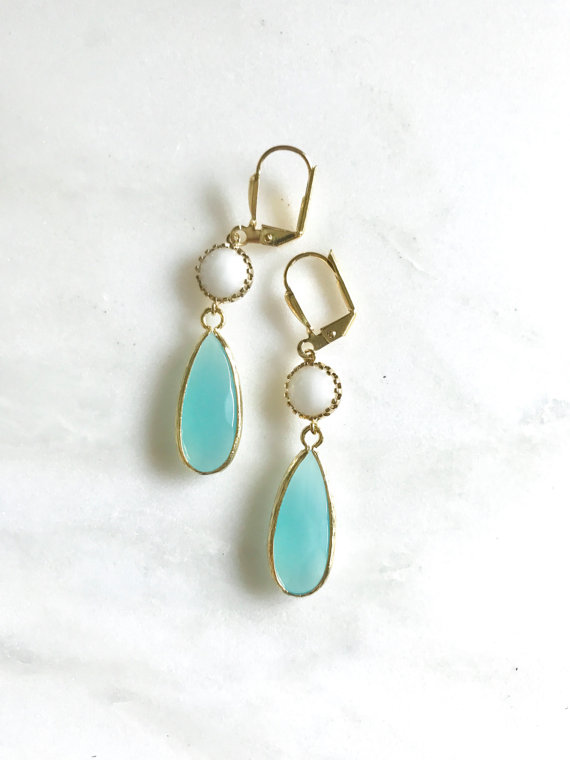 Turquoise, white, and gold come together beautifully in these elegant and sweet earrings. Alive and gorgeous, these earrings will add