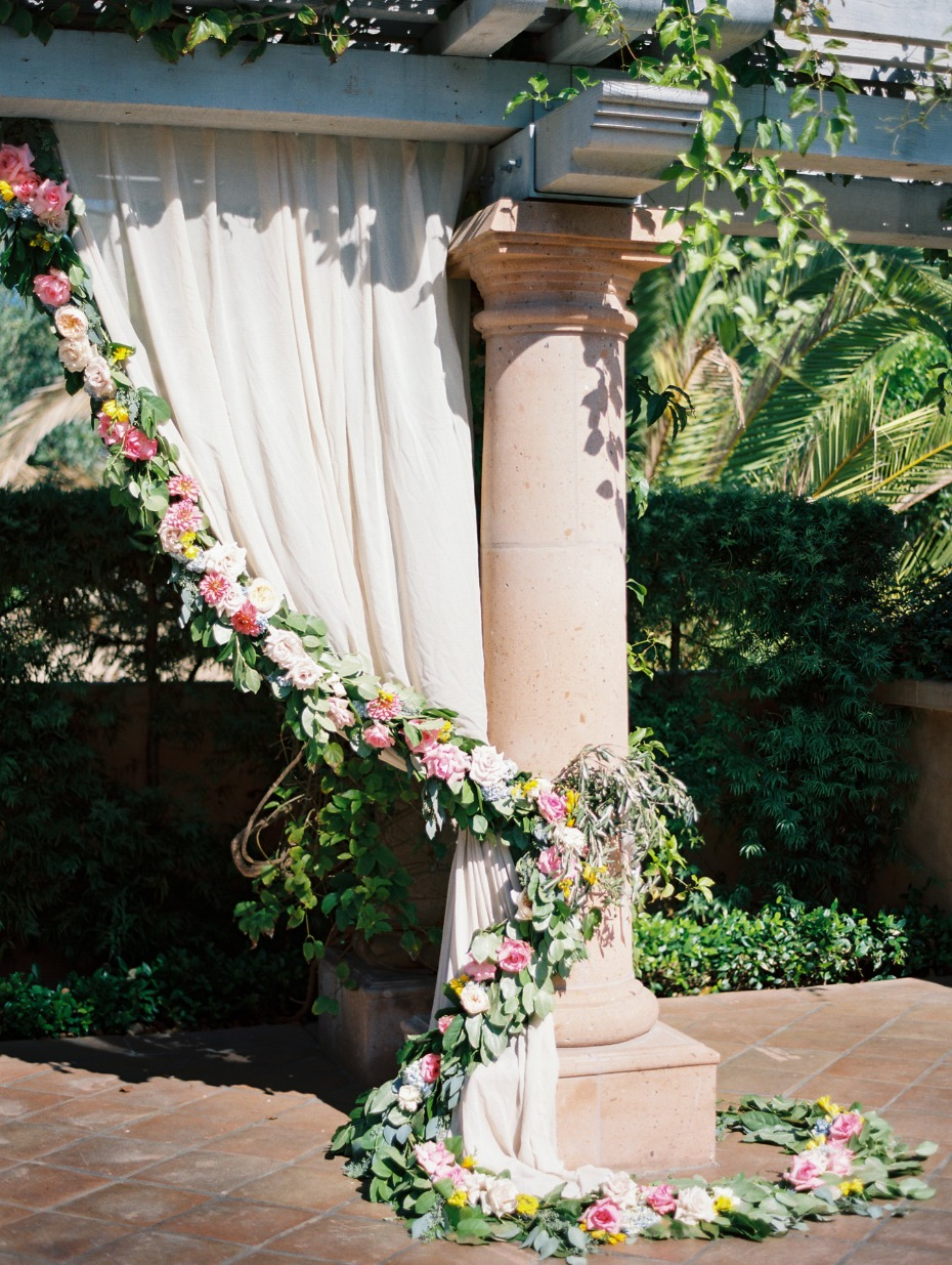 ceremony backdrop curtain with floral garland