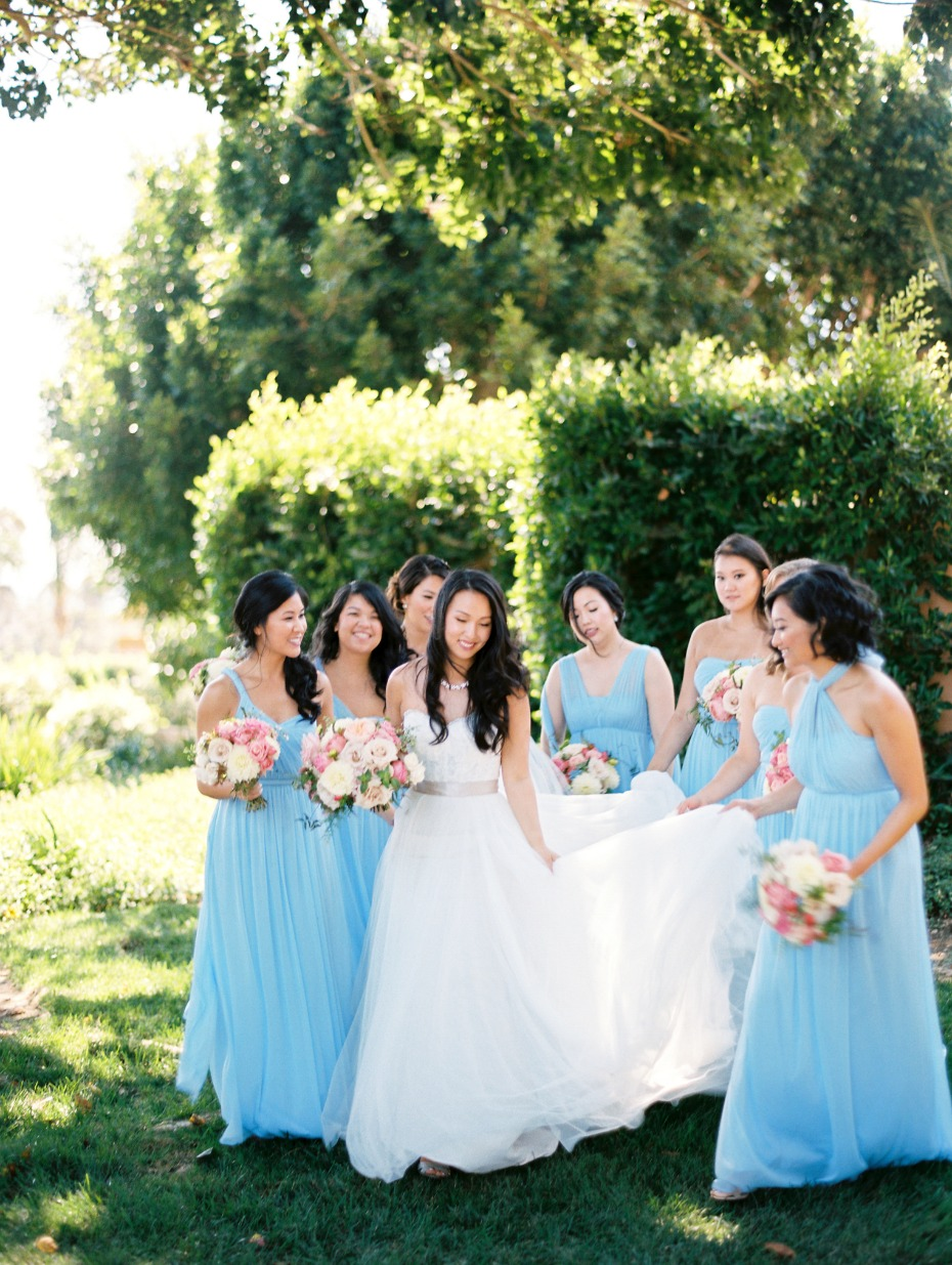 bride and her bridesmaids in light blue