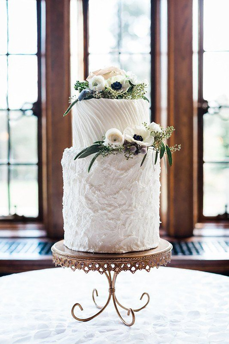 Elegant modern wedding cake idea - Wedding cake with textured frosting and anemone cake topper on Antique Gold metal cake stand with