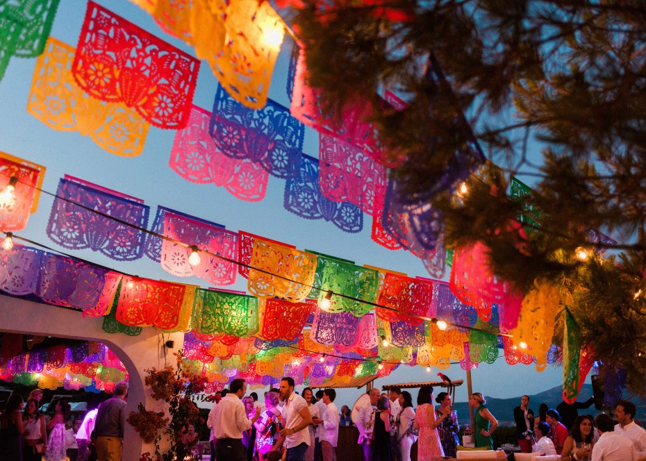colorful papel picado banners for a pre-wedding fiesta