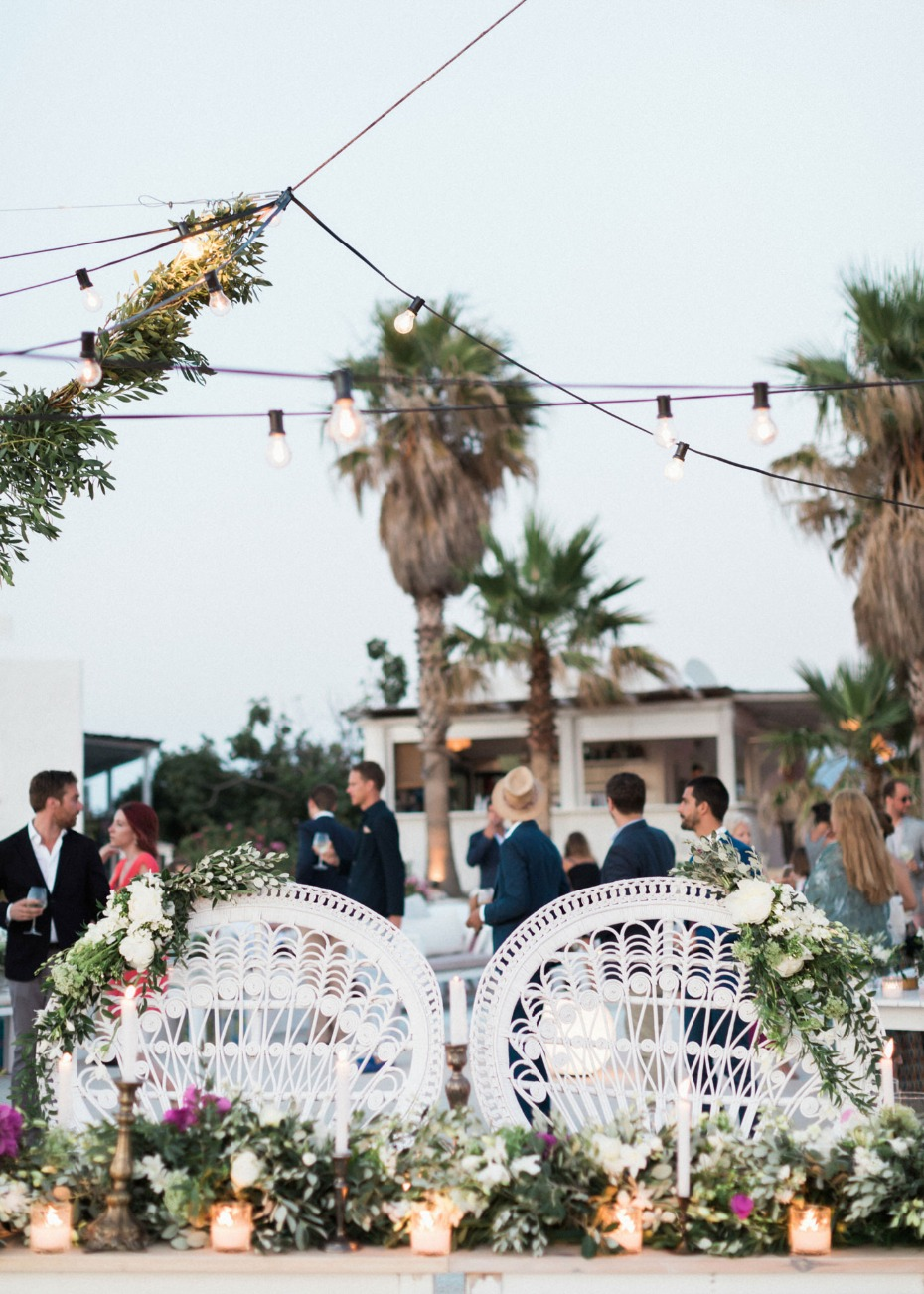 Sweetheart table with peacock chairs