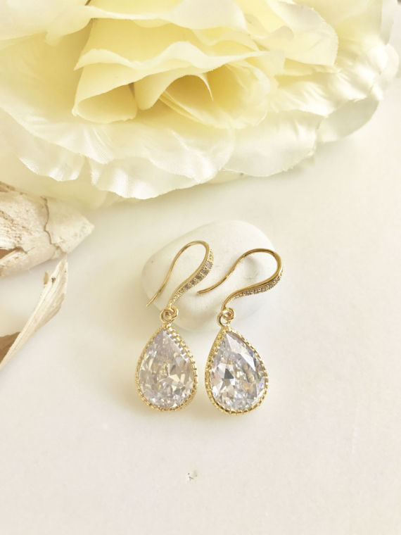 The drops are cubic zirconia set in gold plated brass and measure 12.5x 20mm. The ear wires have cubic zirconia on them as well. The