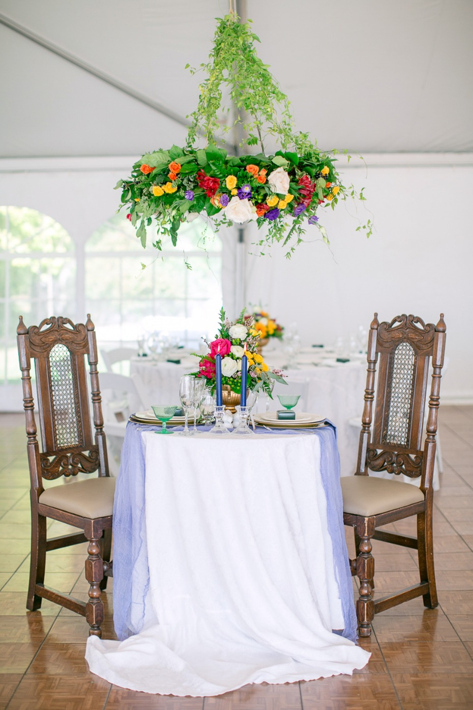 romantic sweetheart table with floral chandelier
