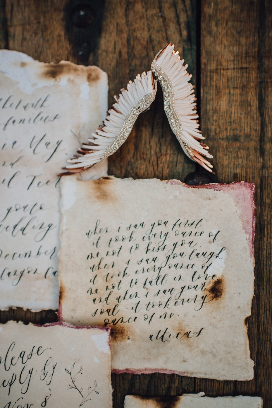 Burnt paper invites and wing earrings