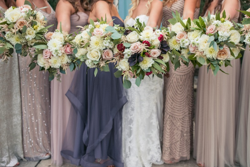 Beautiful florals mixed with mix and match bridesmaid dresses!