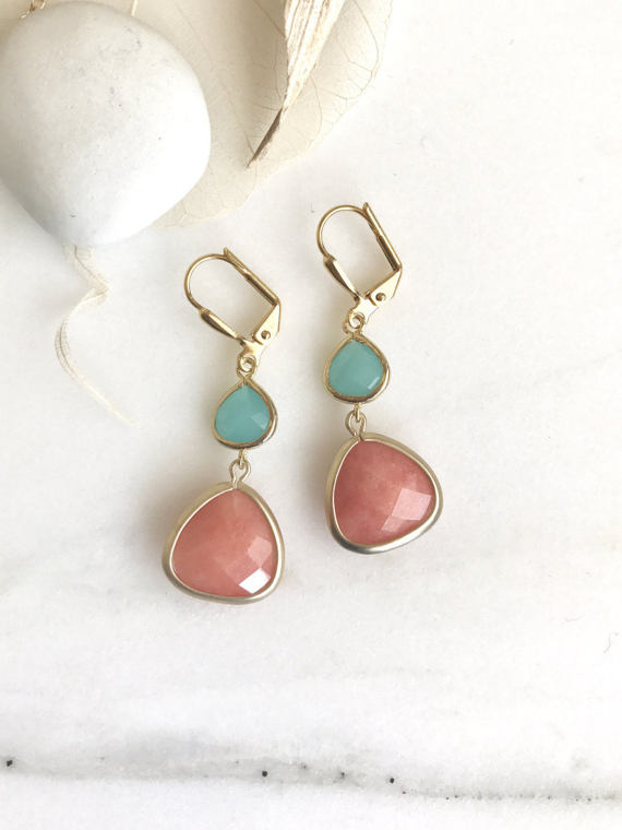 Orange, turquoise, and gold are paired beautifully in these elegant and stunning earrings. Alive and gorgeous, these earrings will