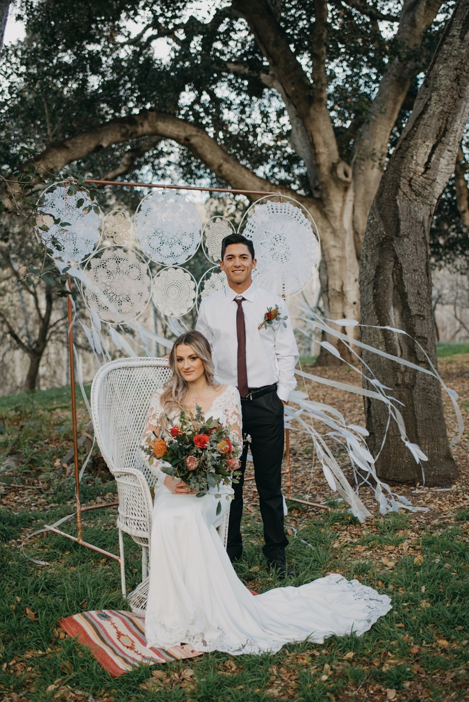 bride and groom with doily dreamcatcher backdrop