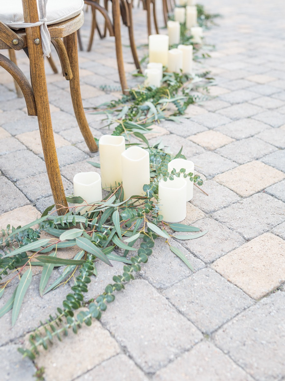 aisle decor idea with greenery and candles