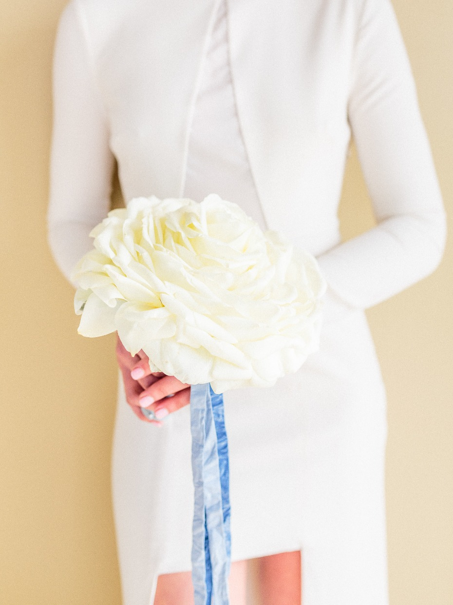 Giant white rose bouquet with blue ribbons