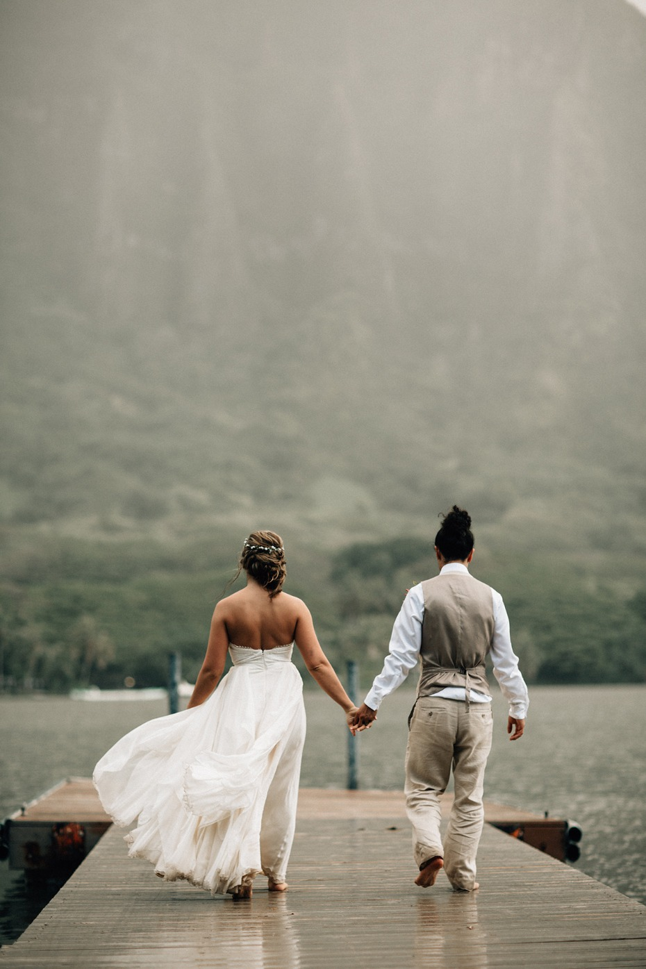sweet bride and groom photos on a dock in Hawaii