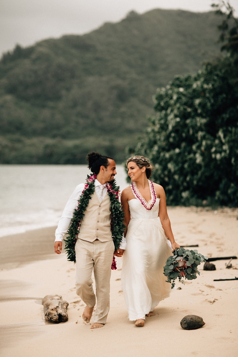 bride and groom on the beach in hawaii