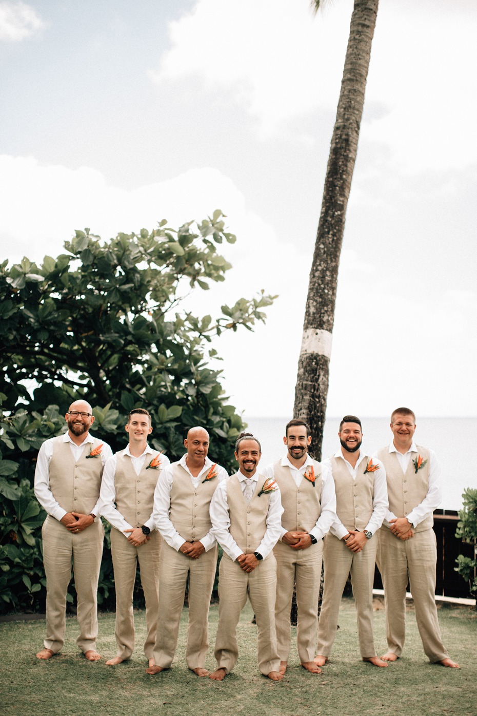 groom and his men in tan beach ready suits