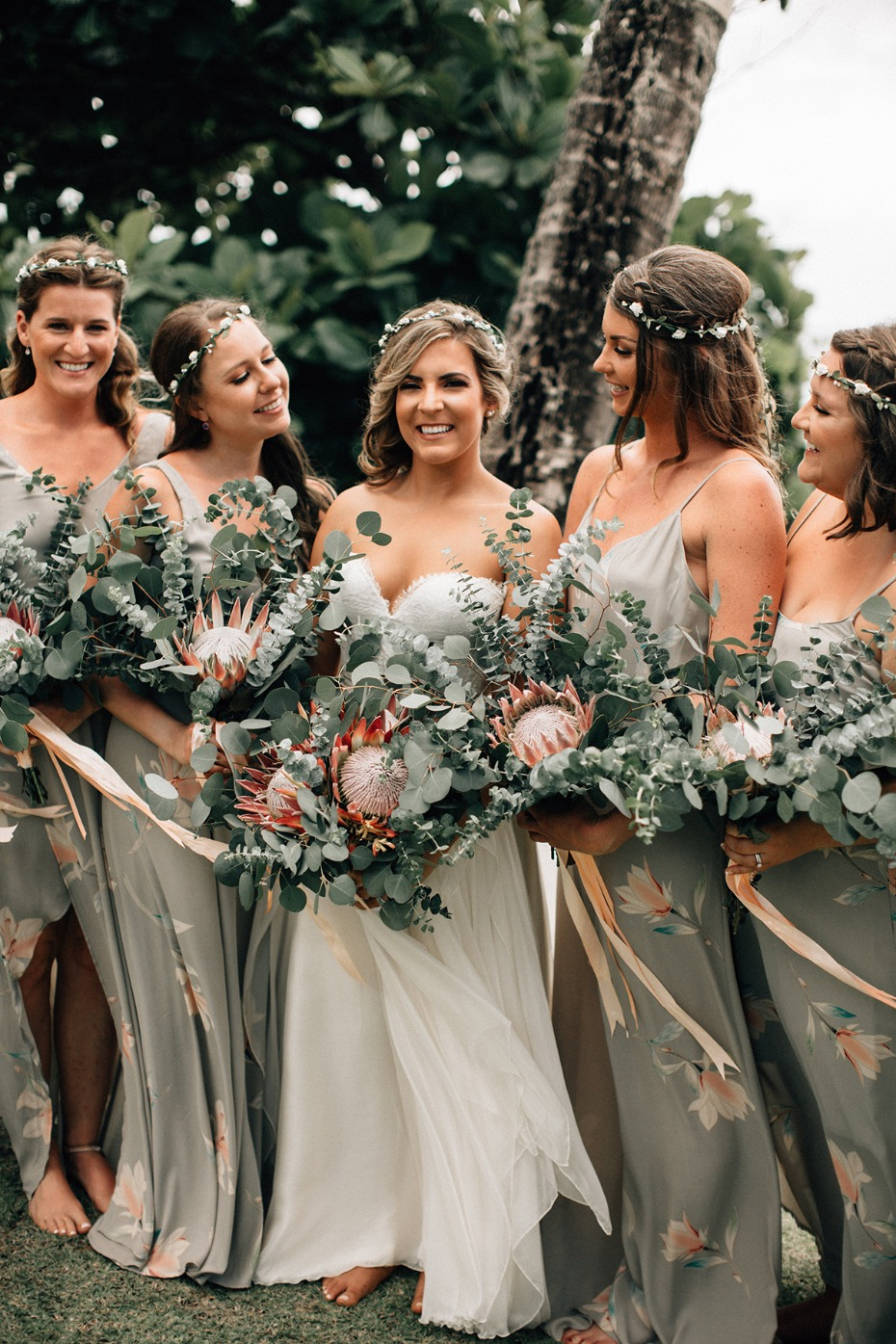 bridesmaids in tropical floral dresses