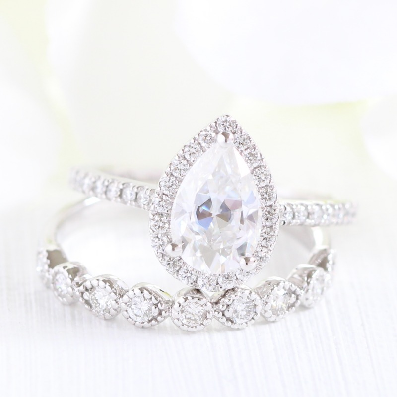 It's fun to mix and match engagement rings with wedding bands! Like this Pear shaped Halo Diamond Moissanite Engagement Ring in Pave
