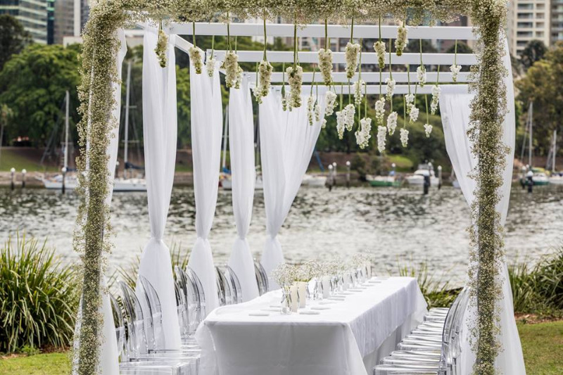 https://www.brisbaneweddingdecorators.com.au/ Luxurious Outdoor Wedding Cocktail Hour Setting by Brisbane Wedding Decorators