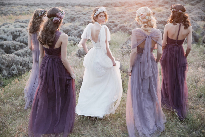 Bridesmaids in the convertible Annabelle dress in lilac and raisin and bride in the Hathaway gown | photo by @thismodernromance