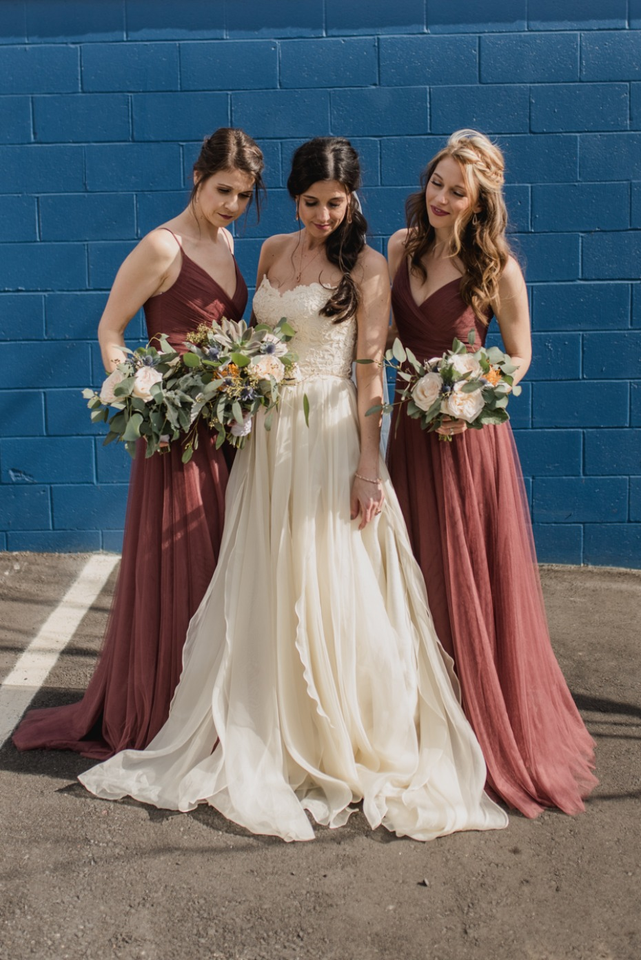 bride and her bridesmaids in marsala dresses