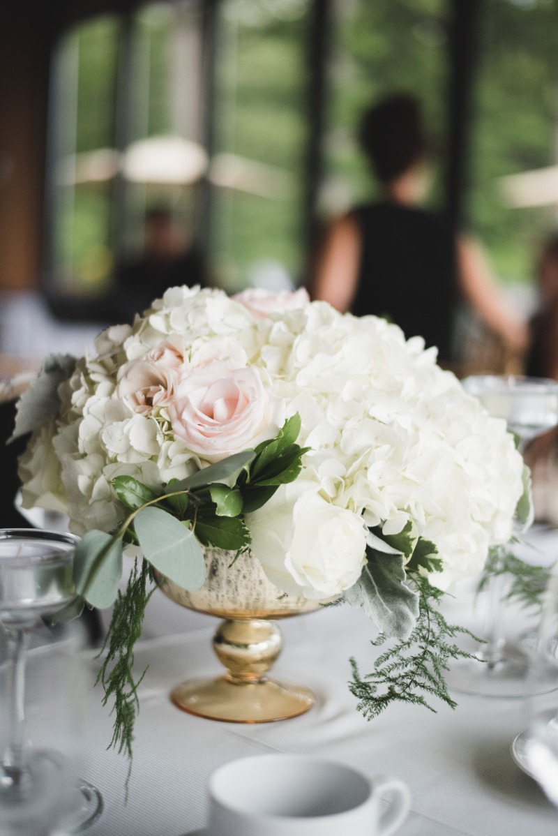 Gold footed compote bowl filled with blooms and foliages perfect for this summer Toronto Wedding.