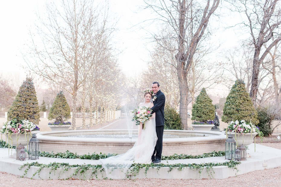 wedding photos by a romantic fountain