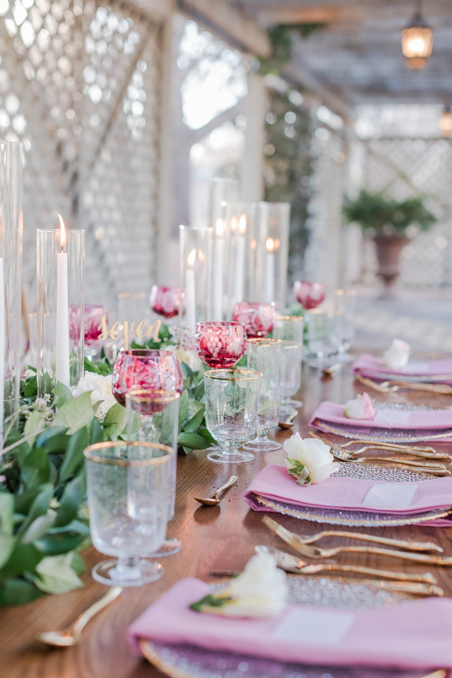 romantic table setting in pink and gold with candles