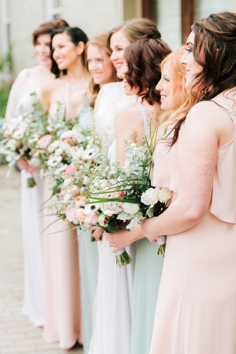 bride and her bridesmaids in pastels