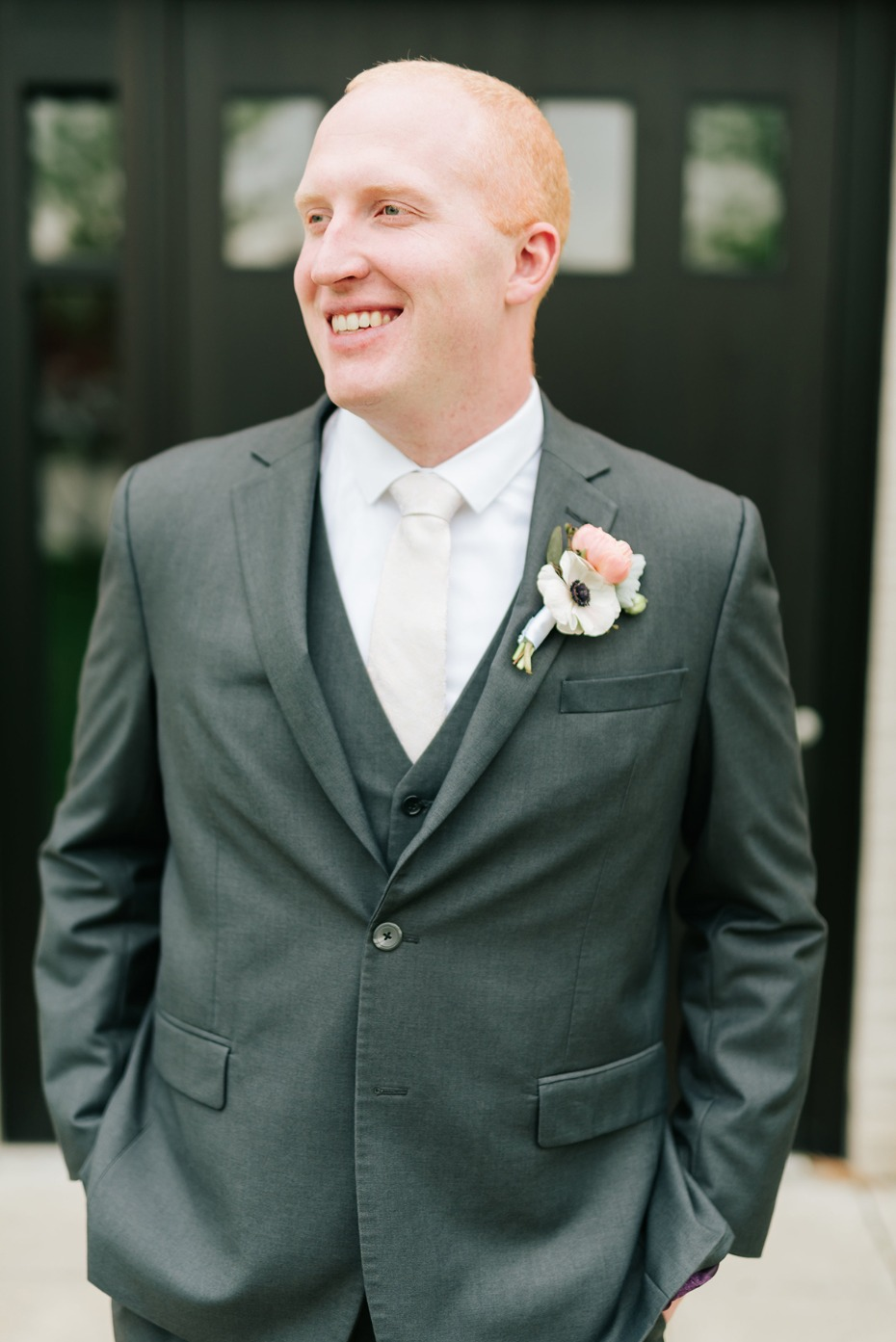 groom in charcoal suit