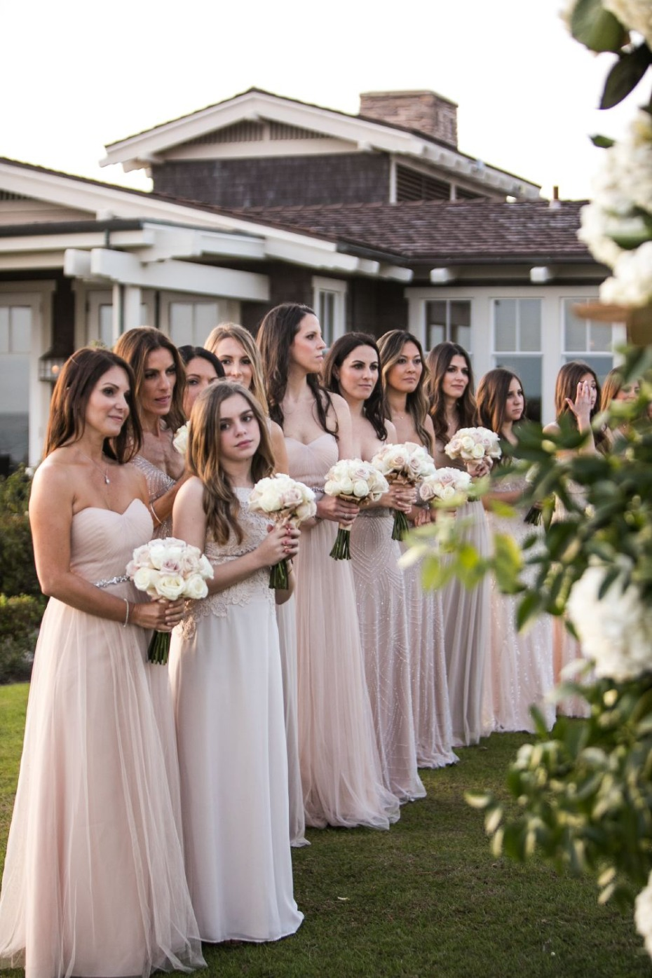 bridesmaids in neutral floor length dresses