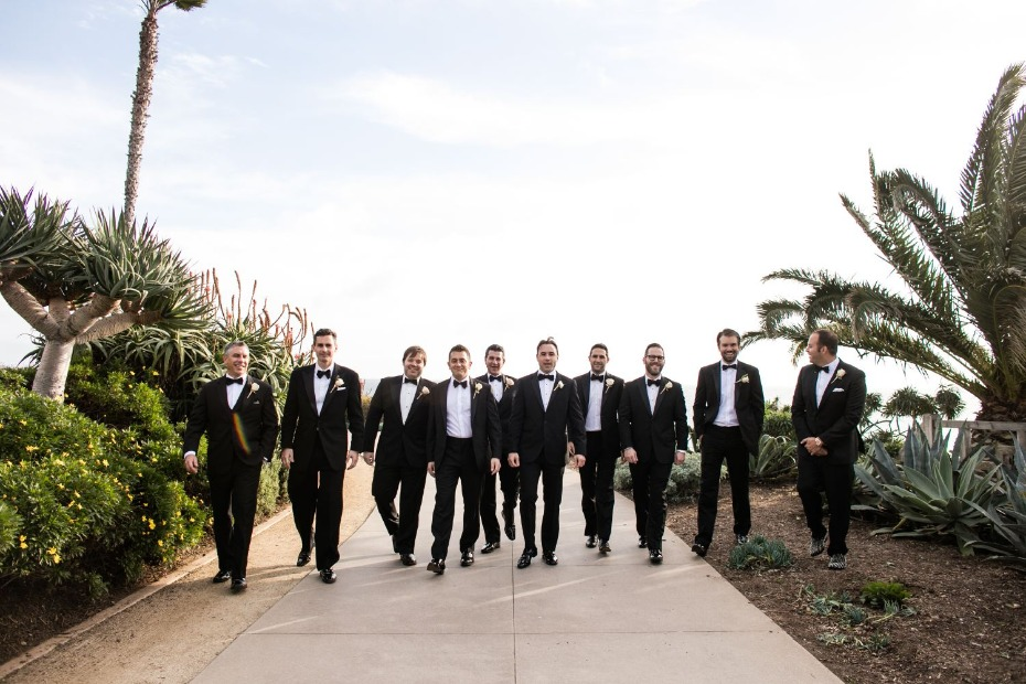 groom and his men in classic black tuxedos
