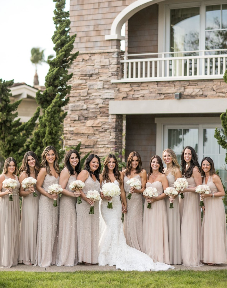 bride and her bridesmaids in neutral dresses