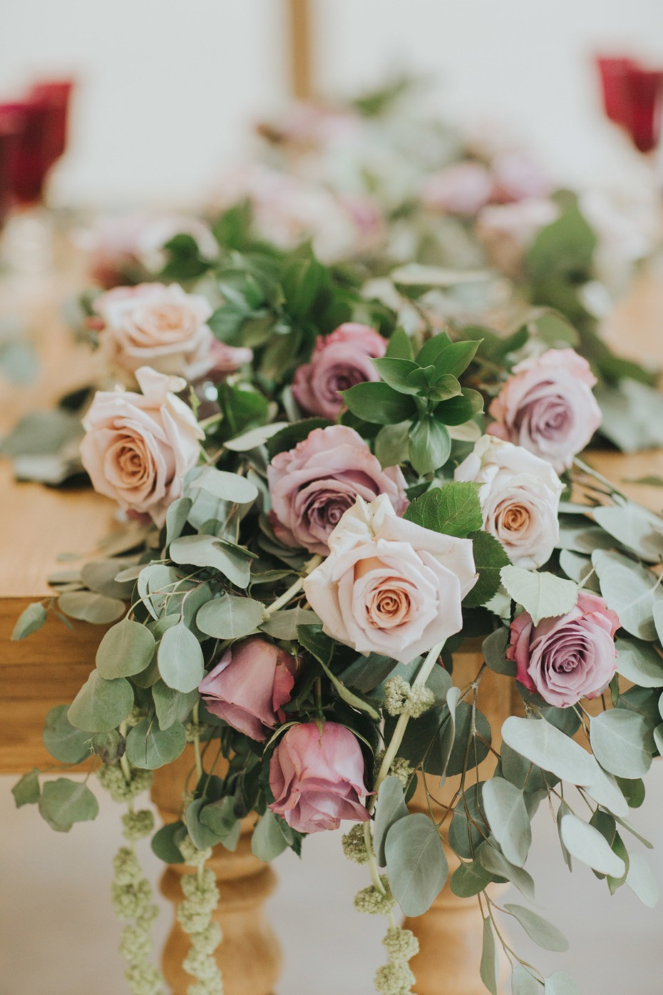 roses and greenery garland centerpiece