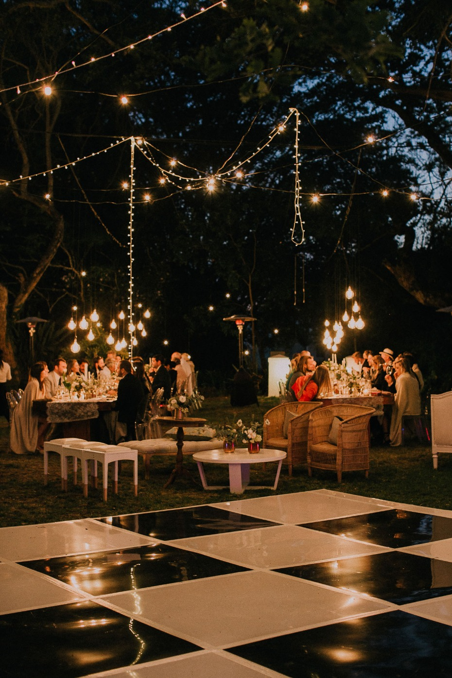 Checkered reception dance floor with hanging lights