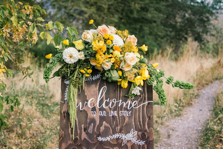 yellow and green floral decorated wedding sign