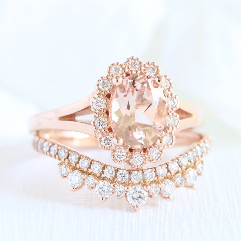 Unique Bridal Set of Oval Morganite Engagement Ring in Vintage Halo Diamond pairs beautifully with Crown Diamond Wedding Ring in Rose