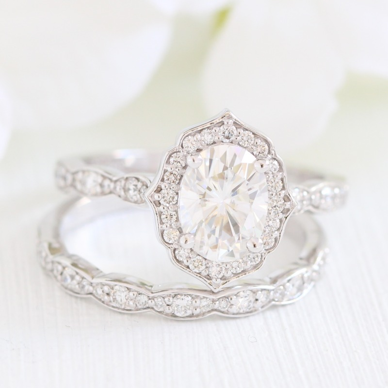Vintage-inspired Bridal Set of Oval Moissanite Engagement Ring and Scalloped Diamond Wedding Band in White Gold Vintage Floral design