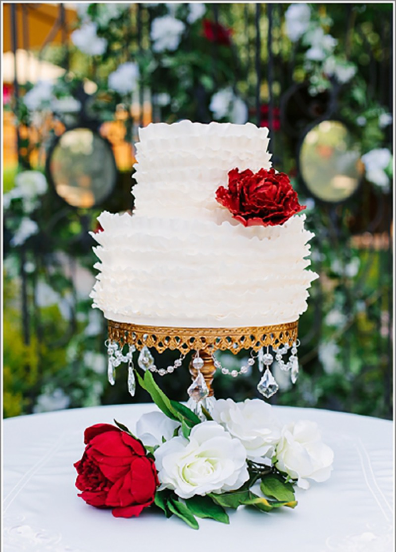 Elegant wedding cake stands with chandelier accents created by Opulent Treasures