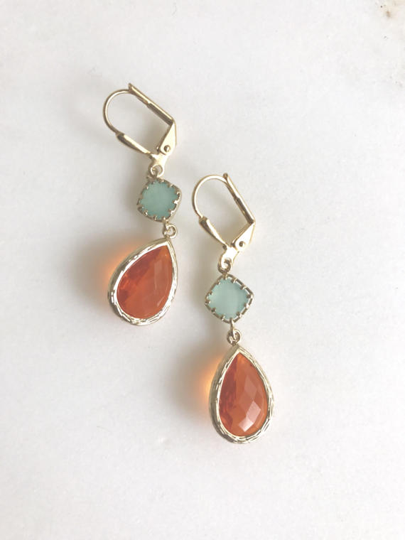 Orange, aqua, and gold are paired beautifully in these elegant and stunning earrings. Alive and gorgeous, these earrings will add a