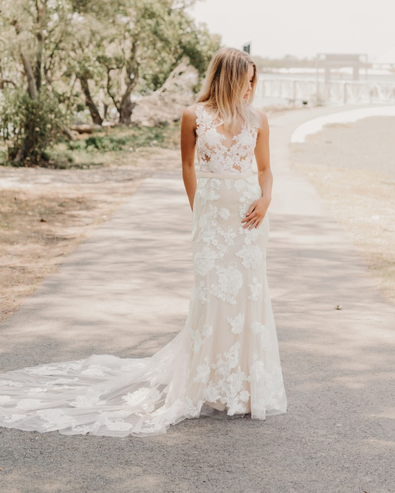 The dreamy boho bridal gown approved by WEDDING CHICKS! The Goddess By Nature Savannah dress with ivory lace appliques and champagne