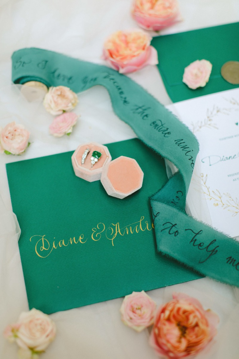 Emerald colored stationary suite and bridal ribbon beautifully calligraphed with a Paolo Coelho quote. #lilyofthevalley_events #weddingingreece