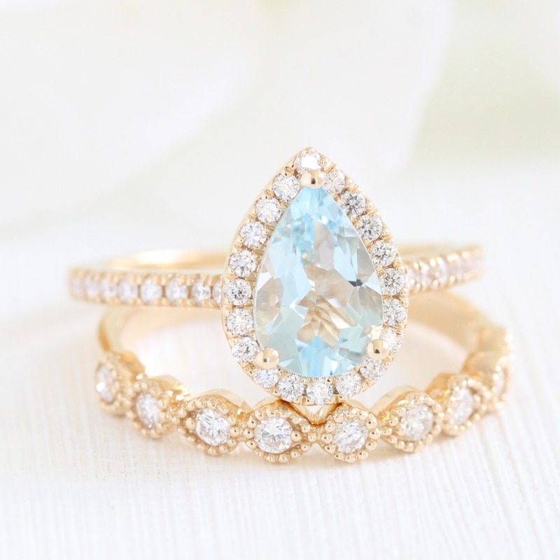 Aqua Blue Beauty! View our collection of Aquamarine Bridal Sets, like this pear shaped Aquamarine surrounded by a halo of diamonds