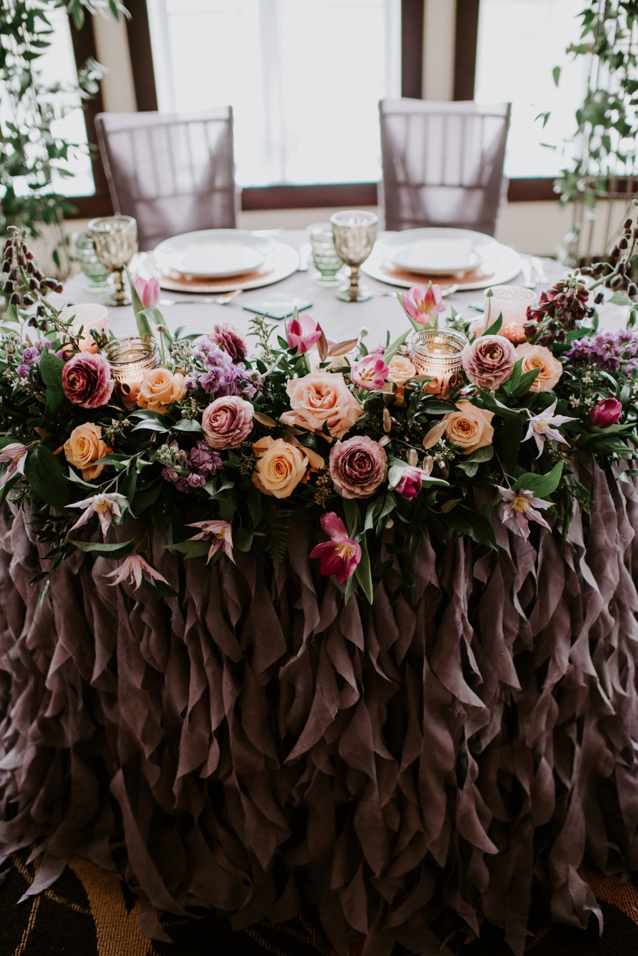 Sweetheart table with florals and ruffles