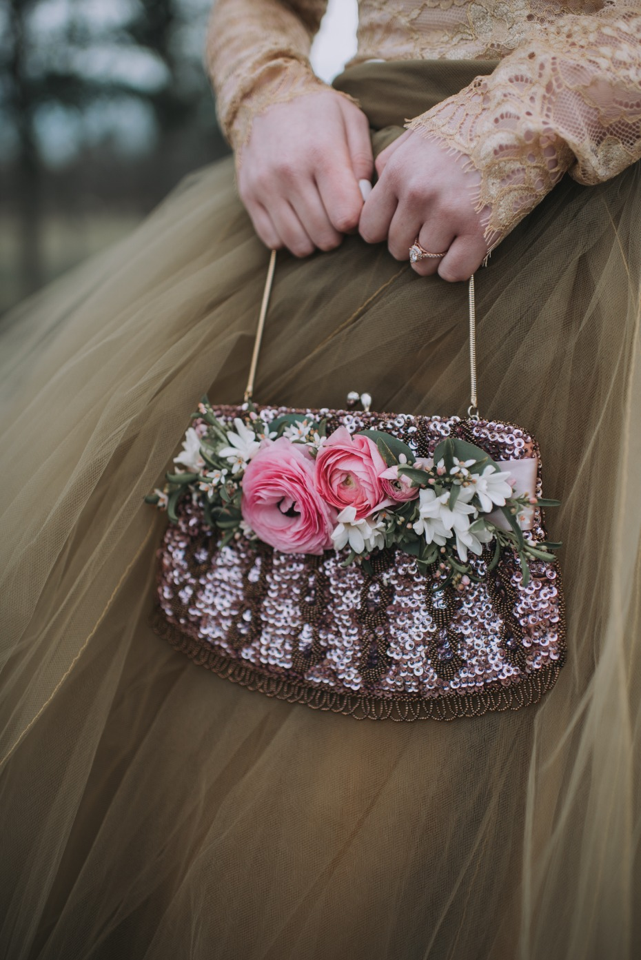 Sparkly flower accented handbag