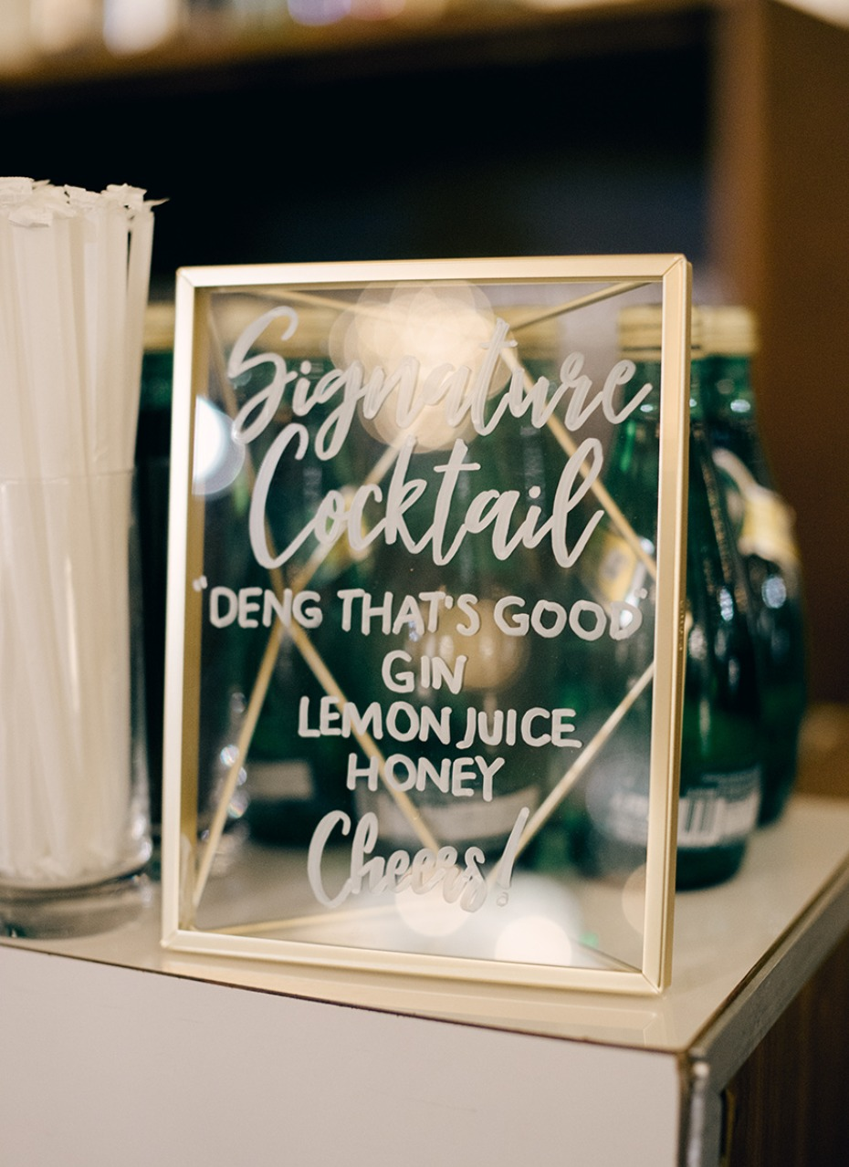glass and gold framed wedding cocktail sign