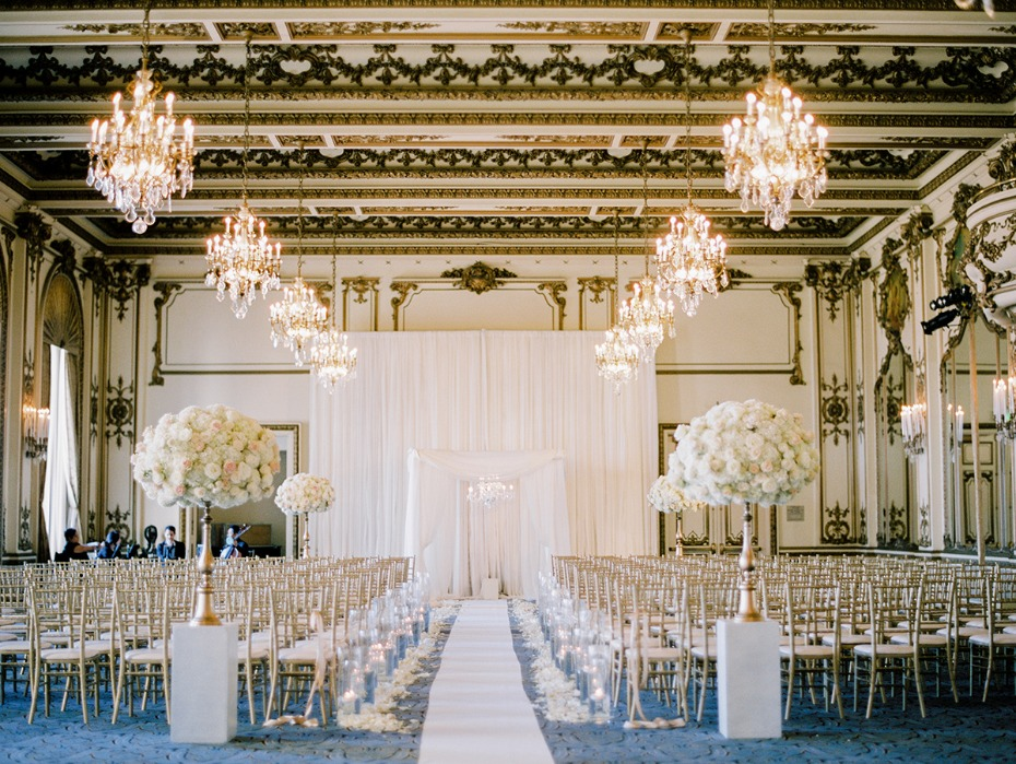 gold room wedding ceremony in glamorous gold and white