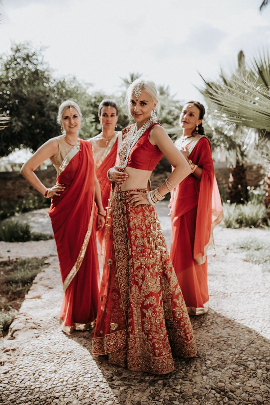bride and bridesmaids in traditional Indian wedding garb