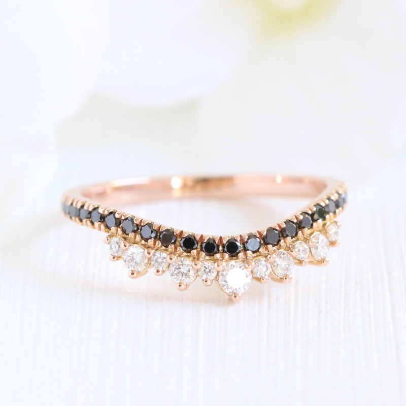 Want a unique wedding band that stands out? See more of La More Design's curved wedding band collection!