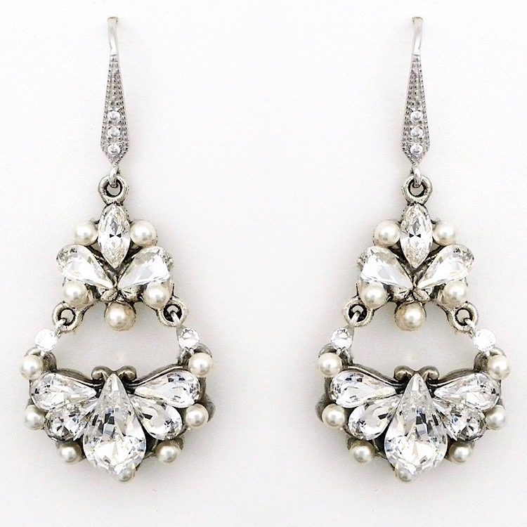 Open, airy chandelier earrings create a delicate feel with with a dazzling design of crystal teardrops enhance by accents of small