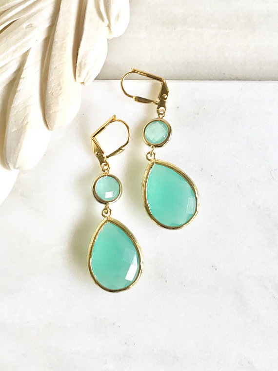 Aqua and gold are paired beautifully in these elegant and stunning earrings. Alive and gorgeous, these earrings will add a beautiful