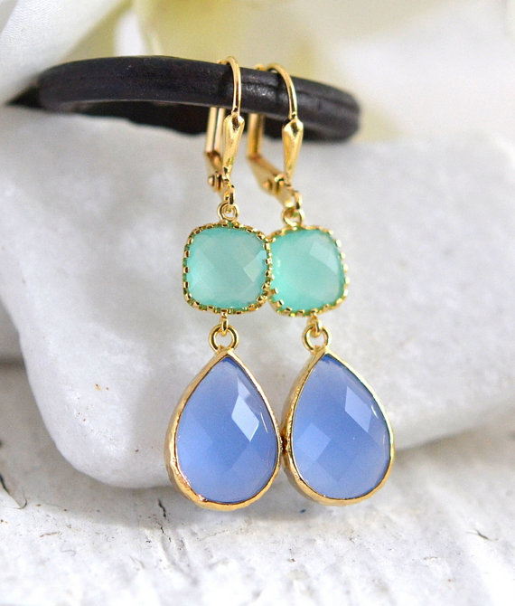 Periwinkle, aqua, and gold come together beautifully in these elegant and stunning earrings. Alive and gorgeous, these earrings will