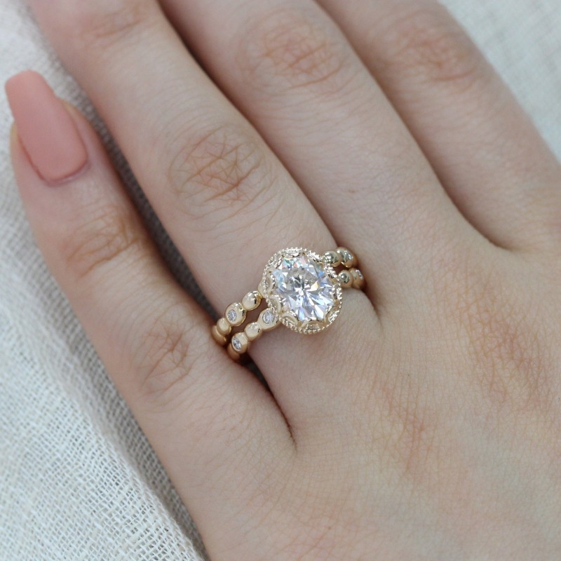 Gorgeous Bridal Set of Oval Moissanite in Floral Basket design with Pebble Diamond Band and matching wedding band in Yellow Gold ~